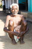 Old indian tribal man in the village Stock Images