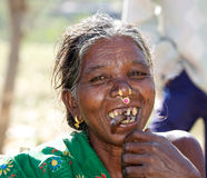 Old indian tribal woman with earrings and cigar Stock Photo