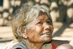 Old indian woman with earrings and tatto face Royalty Free Stock Photo