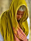 Old Indian Woman Praying. An elderly woman is sincerely praying to her God in India Stock Photo