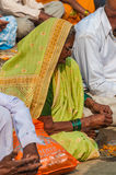 Old Indian woman prays at Varanasi, India. An old Indian woman takes part in a ceremony on the River Ganges in Varanasi Royalty Free Stock Image