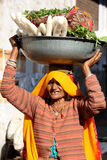 Old Indian woman selling vegetables in the street Royalty Free Stock Image