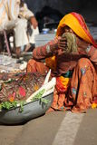 Old Indian woman selling vegetables in the street Stock Photography