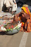 Old Indian woman selling vegetables in the street stock images
