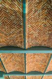 Old industrial barrel vault in textile factory. Old industrial barrel vault of brick stones with steel elements in former textile factory in Lodz, central Poland Royalty Free Stock Photos
