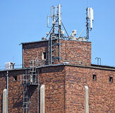 Old industrial building with antennas Royalty Free Stock Image