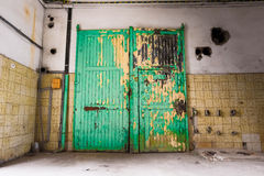 An old industrial building, a closed  door Royalty Free Stock Images