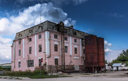 Old industrial building crumbling with time Royalty Free Stock Image