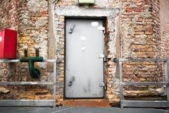 Old industrial building exterior wall, door Stock Photo