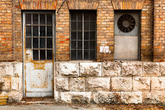 Old industrial building exterior wall, door and window Royalty Free Stock Photography