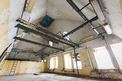 An old industrial building interior, windows Royalty Free Stock Photos