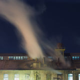 Old industrial chimneys at night Royalty Free Stock Images
