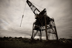 Old industrial crane Stock Images