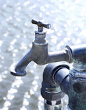 Old industrial faucet with water Royalty Free Stock Photography