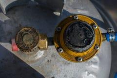 Gas valve. Old industrial gas valve. rotten, rusty, very dangerous Stock Photo
