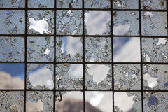 Old Industrial iron window frame rusting with broken glass. Old Industrial iron window frame rusting with broken glass at abandoned train station at the border royalty free stock photo