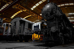 Old industrial locomotive in the garage stock photos