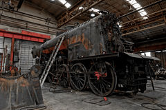 Old industrial locomotive in the garage Royalty Free Stock Photography