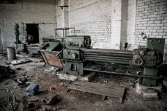 Old industrial machine tools and rusty metal equipment in abandoned factory Royalty Free Stock Photography