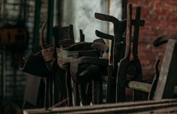 Old industrial machine tools in workshop. Rusty metal equipment in abandoned factory. 2019 royalty free stock photo