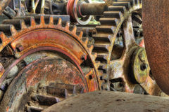 Old Industrial Machinery Gears. These wheels and gears are on an industrial machine from the early 1900's Stock Photo