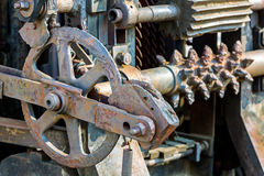 Old industrial mechanism closeup. rusty cogwheels and gears. Royalty Free Stock Photography