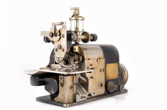 Old Industrial Overlock Sewing Machine Royalty Free Stock Image