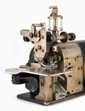 Old Industrial Overlock Sewing Machine Detail. Stock Photos