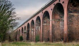 A row of arches on a railway viaduct or bridge. stock photos