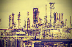 Old industrial plant with gray sky, vintage retro style. Royalty Free Stock Photo