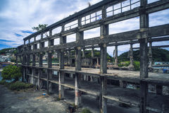 Old industrial ruins building - Agenna Shipyard Ruins with afternoon cloudy sky , shot in Zhongzheng District, Keelung, Taiwan. Royalty Free Stock Photography