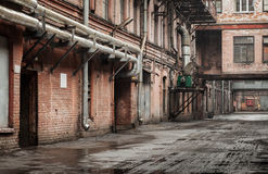 Old industrial street view with red brick facades Stock Photo