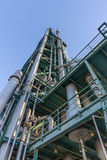Old industrial structure produce fuel refinery Stock Photos