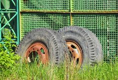Old industrial truck wheel on wasteland Stock Image
