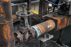 Old industrial valve and pipework. Royalty Free Stock Images