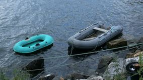 Old inflatable boats near the coastline of north sea stock video footage