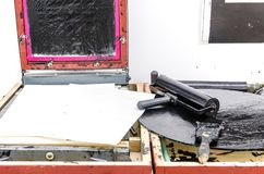 Old ink copying equipment. On the table, drum, wax paper and ink stock photo