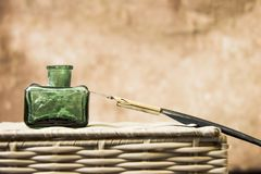 Vintage inkwell and a pen royalty free stock photo