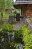 Old inn with a mill near a small pond. As in the Soviet cartoon Cossacks stock image