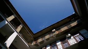 Old Inner Apartments Building. Old apartments building with inner yard stock footage