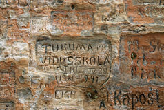 Old  inscriptions in the Gautmanis Cave located on the Gauja River in the National Park of Sigulda, Latvia Royalty Free Stock Images