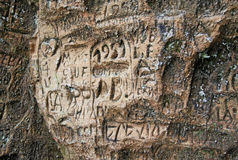 Old  inscriptions in the Gautmanis Cave located on the Gauja River in the National Park of Sigulda, Latvia Stock Photo