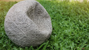 Old inside football and deflated ball on green lawn background Stock Image