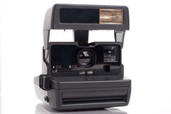 Old instant analog film camera. Over white background Stock Images