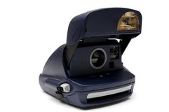 Old instant camera. On a white background Royalty Free Stock Photo