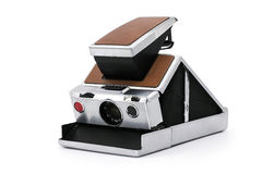 Old instant camera on white background. Being opened Stock Photos