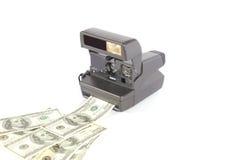 Old instant film camera. Making money Stock Photo
