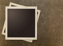 Old instant photo polaroid frames on grunge canvas Stock Photos