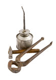 Old instrument. The old dirty tin oilcan nail nippers hammer with wood handle isolated Royalty Free Stock Photography
