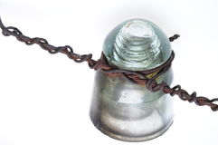Old insulator for telecommunication lines with a rusty wire Royalty Free Stock Images